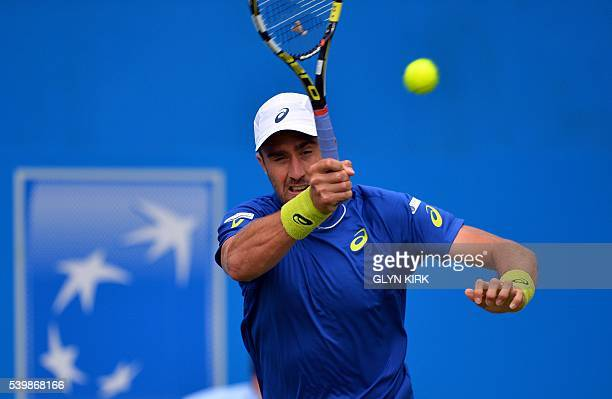 Player Steve Johnson plays a forehand during his men's singles match against France's Richard Gasquet at the ATP tournament at Queen's tennis club,...