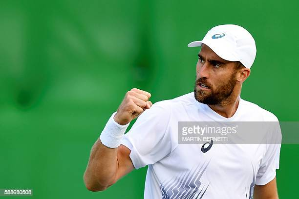 US player Steve Johnson reacts after a point against Britain's Andy Murray during their men's singles quarterfinals tennis match at the Olympic...