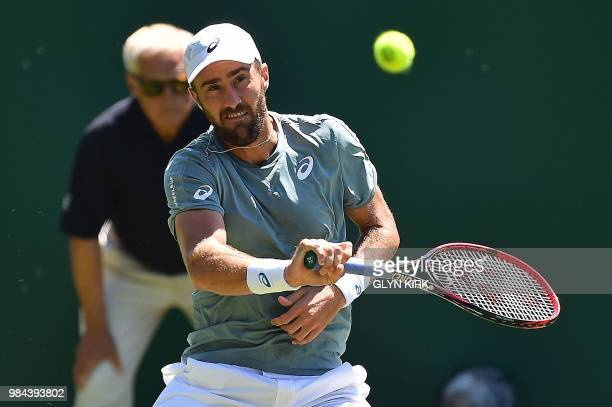 US player Steve Johnson returns against Rusia's Daniil Medvedev during their Men's singles first round match at the ATP Nature Valley International...