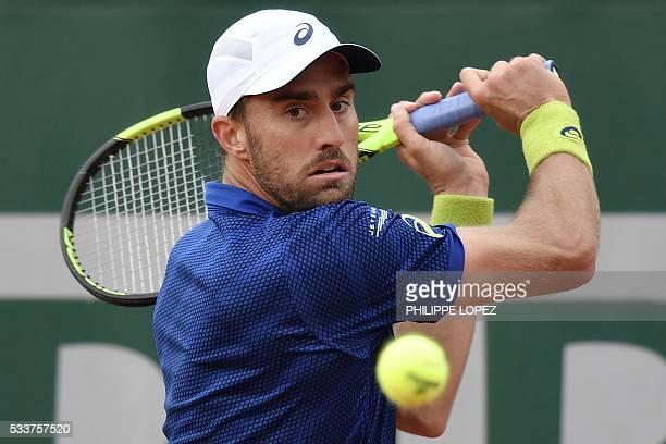 Player Steve Johnson returns the ball to Spain's Fernando Verdasco during their men's first round match at the Roland Garros 2016 French Tennis Open...