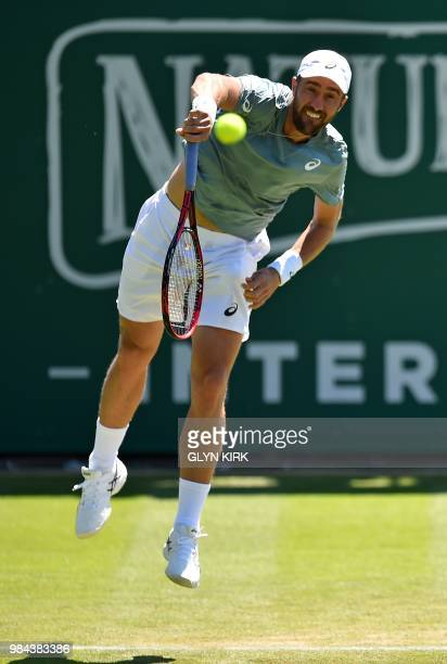 US player Steve Johnson serves against Rusia's Daniil Medvedev during their Men's singles first round match at the ATP Nature Valley International...