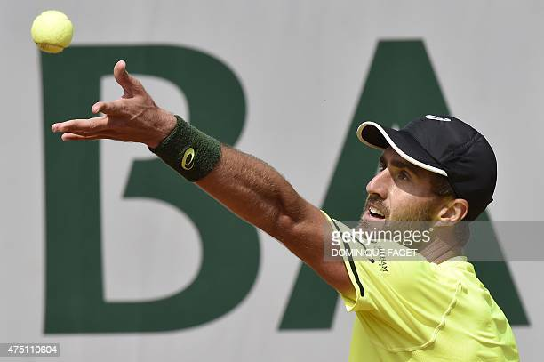 US player Steve Johnson serves against Switzerland's Stanislas Wawrinka during the men's third round of the Roland Garros 2015 French Tennis Open in...