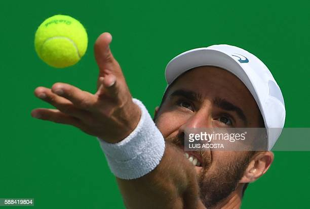 Player Steve Johnson serves the ball to Russia's Evgeny Donskoy during their men's singles third round tennis match at the Olympic Tennis Centre of...