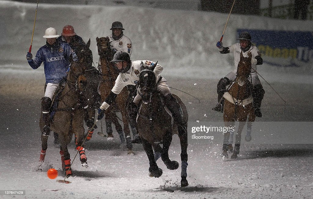 A player swings for the ball at the annual Klosters Snow Polo event in Klosters, Switzerland, on Friday, Jan. 20, 2012. German Chancellor Angela Merkel will open next week's World Economic Forum in Davos, Switzerland, which will be attended by policy makers and business leaders including U.S. Treasury Secretary Timothy F. Geithner. Photographer: Scott Eells/Bloomberg via Getty Images