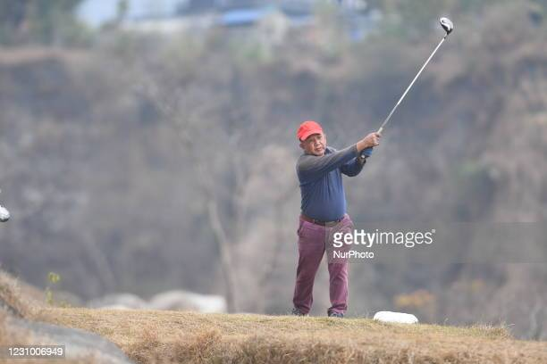 Player takes his shot during the Baahrakhari Golf n Pokhara, Nepal on February 6, 2021.