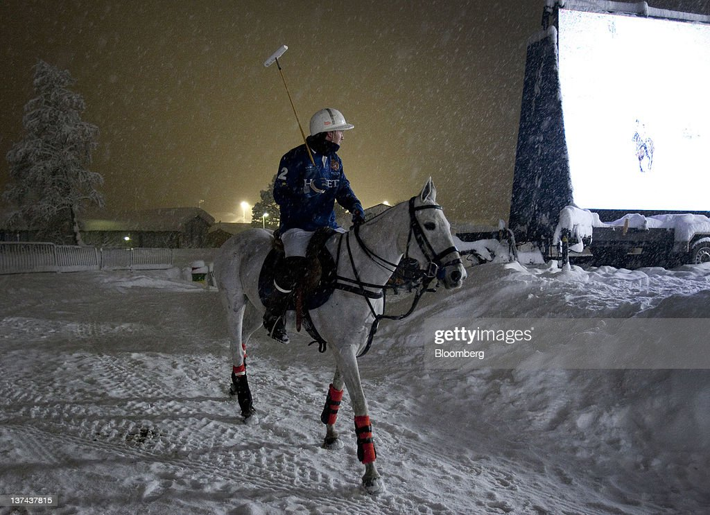 A player takes to the field at the annual Klosters Snow Polo event in Klosters, Switzerland, on Friday, Jan. 20, 2012. German Chancellor Angela Merkel will open next week's World Economic Forum in Davos, Switzerland, which will be attended by policy makers and business leaders including U.S. Treasury Secretary Timothy F. Geithner. Photographer: Scott Eells/Bloomberg via Getty Images