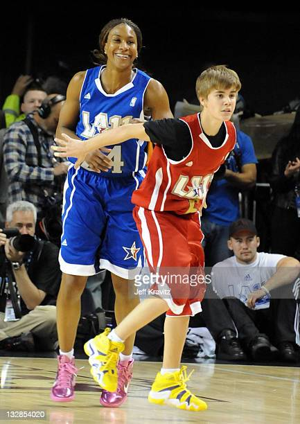 Player Tamika Catchings and Singer Justin Bieber during the 2011 BBVA NBA AllStar Celebrity Game at Los Angeles Convention Center on February 18 2011...