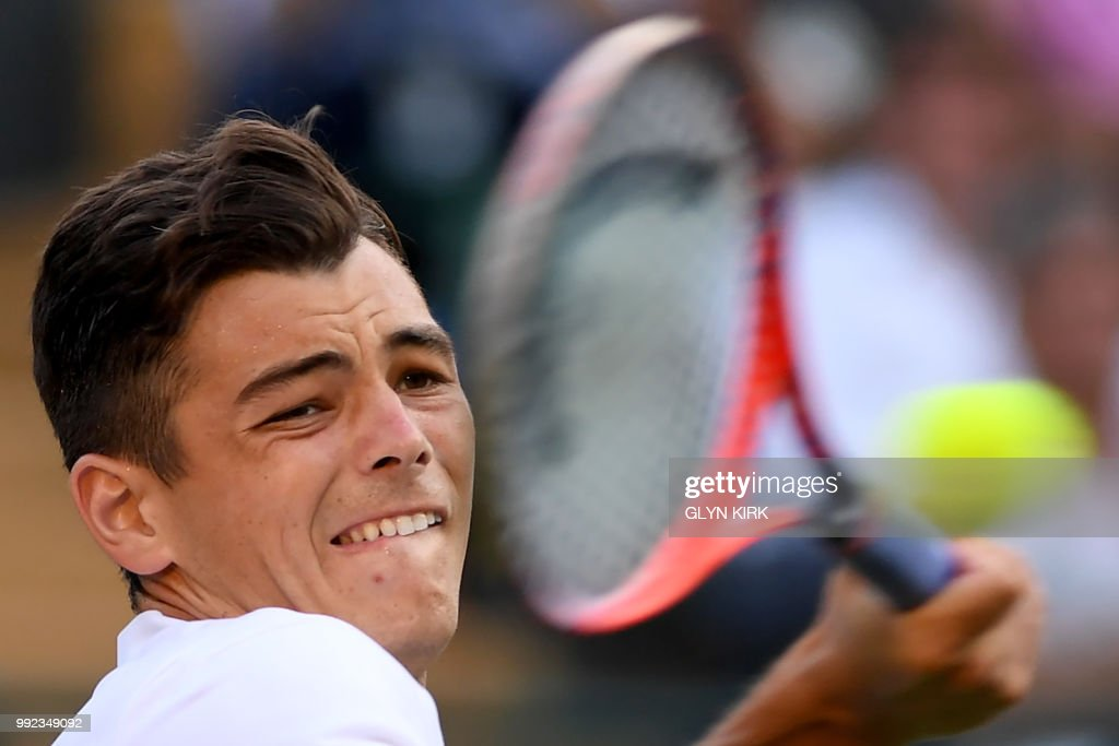 TOPSHOT - US player Taylor Fritz returns against Germany's Alexander Zverev during their men's singles second round match on the fourth day of the 2018 Wimbledon Championships at The All England Lawn Tennis Club in Wimbledon, southwest London, on July 5, 2018. (Photo by Glyn KIRK / AFP) / RESTRICTED