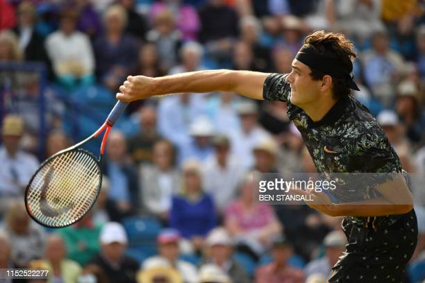 US player Taylor Fritz serves to Britain's Kyle Edmund during their men's singles semifinal match at the ATP Nature Valley International tennis...