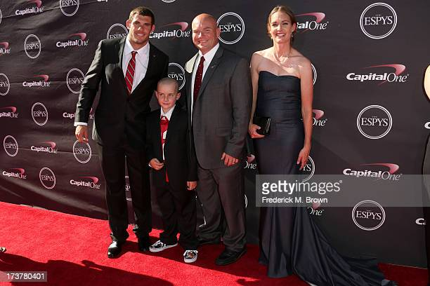NFL player Taylor Martinez Jack Hoffman with his dad Andy Hoffman and mom Bri Hoffman attend The 2013 ESPY Awards at Nokia Theatre LA Live on July 17...