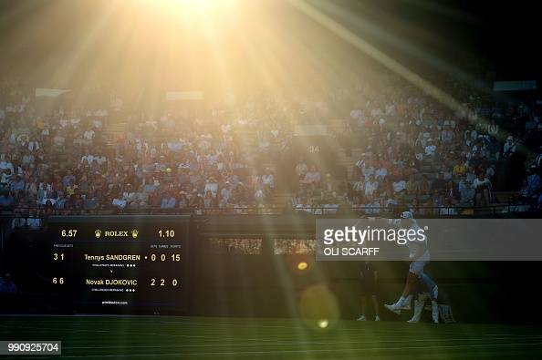 Player Tennys Sandgren serves against Serbia's Novak Djokovic during their men's singles first round match on the second day of the 2018 Wimbledon...