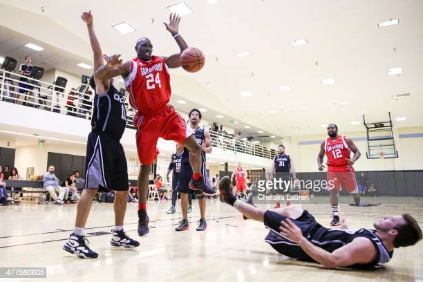 NFL player Terrell Owens and actor Jimmy Tatro attend the ELeague celebrity basketball league game at Equinox Sports Club West LA on March 9 2014 in...