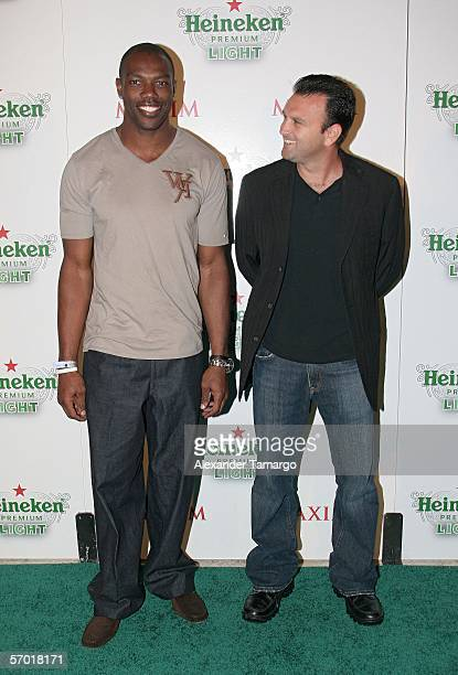 Player Terrell Owens and his agent Drew Rosenhaus pose at the Heineken Premium Light launch party at Casa Casuarina on March 6, 2006 in Miami Beach ,...