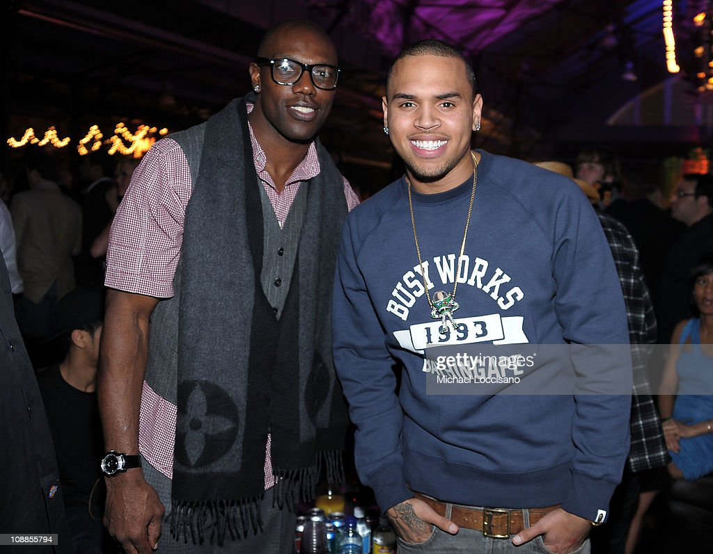 NFL player Terrell Owens (L) and singer Chris Brown attend the Maxim Party Powered by Motorola Xoom at Centennial Hall at Fair Park on February 5, 2011 in Dallas, Texas.