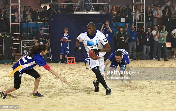 NFL player Terrell Owens plays football at DIRECTV's Sixth Annual Celebrity Beach Bowl Game at Victory Field on February 4 2012 in Indianapolis...