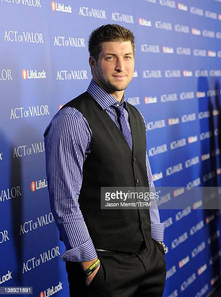 Player Tim Tebow of the Denver Broncos arrives at the premiere of Relativity Media's Act Of Valor held at ArcLight Cinemas on February 13 2012 in...