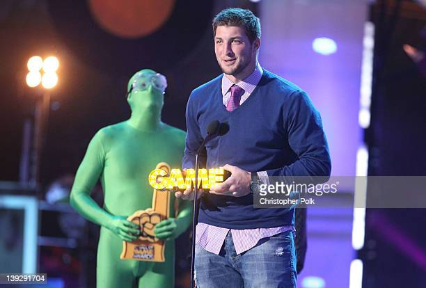NFL player Tim Tebow speaks onstage during the 2012 Cartoon Network Hall of Game Awards at Barker Hangar on February 18 2012 in Santa Monica...