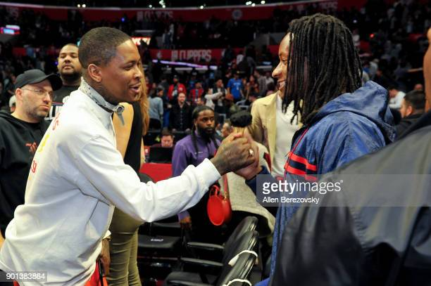 NFL player Todd Gurley and Rapper YG attend a basketball game between the Los Angeles Clippers and the Oklahoma City Thunder at Staples Center on...