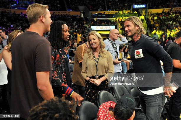 NFL player Todd Gurley Lakers president Jeanie Buss and David Beckham attend a basketball game between the Los Angeles Lakers and the Washington...