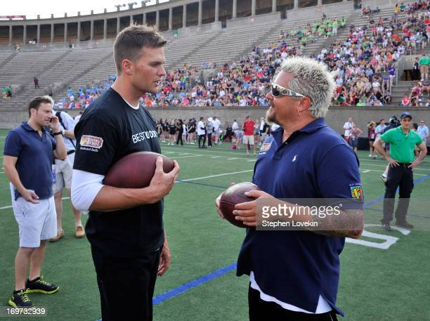 Player Tom Brady and Chef Guy Fieri attend the Tom Brady Football Challenge for the Best Buddies Challenge Hyannis Port on May 31 2013 in Boston...