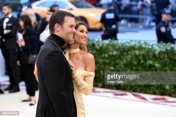 NFL player Tom Brady and model Gisele Bundchen attend the Heavenly Bodies Fashion The Catholic Imagination Costume Institute Gala at The Metropolitan...