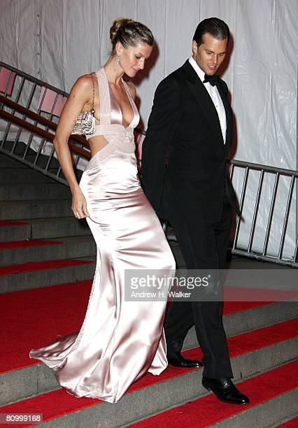 NFL player Tom Brady and model Gisele Bundchen depart from the Metropolitan Museum of Art Costume Institute Gala Superheroes Fashion and Fantasy held...