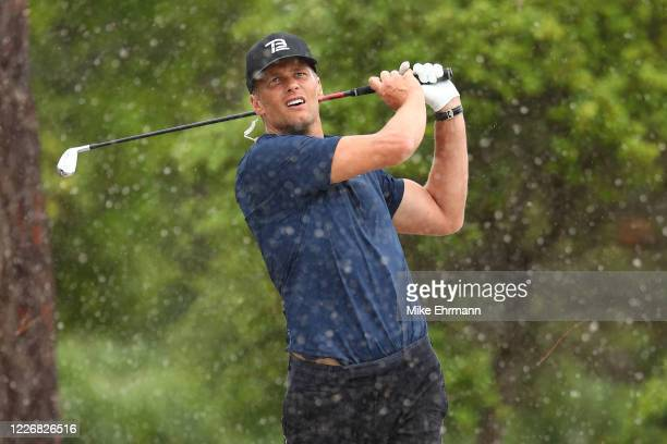 Player Tom Brady of the Tampa Bay Buccaneers plays a shot from the sand on the seventh hole during The Match: Champions For Charity at Medalist Golf...