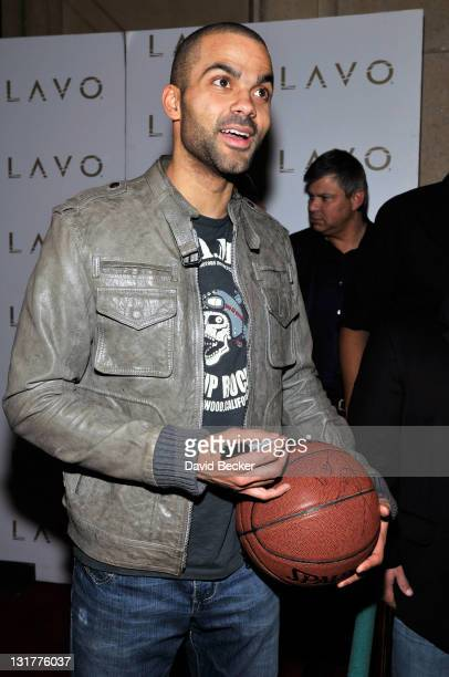 NBA player Tony Parker autographs a basketball after he arrived at the Baller's Ball at the Lavo Nightclub at The Palazzo on February 19 2011 in Las...