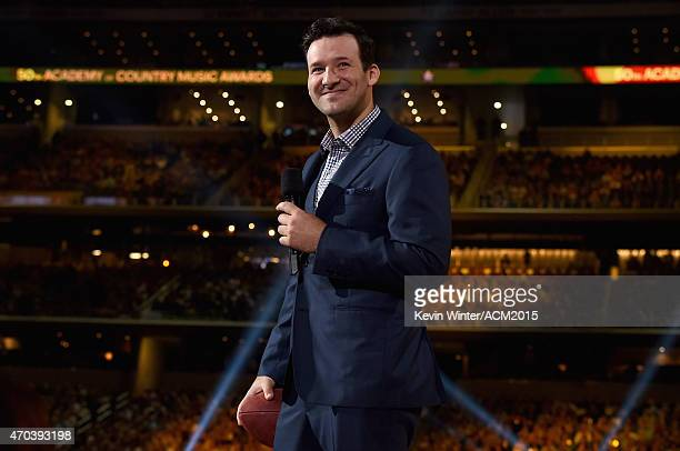 NFL player Tony Romo speaks onstage during the 50th Academy of Country Music Awards at ATT Stadium on April 19 2015 in Arlington Texas