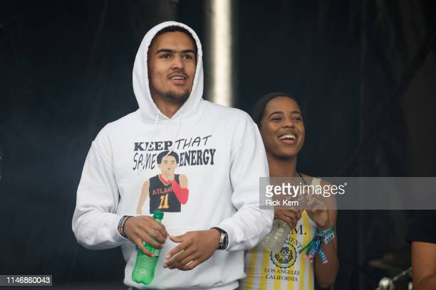 NBA player Trae Young attends YoungBoy Never Broke Again's performance during JMBLYA at Fair Park on May 03 2019 in Dallas Texas