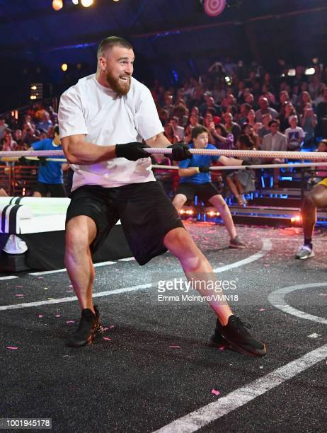 NFL player Travis Kelce particaptes in a challenge during the Nickelodeon Kids' Choice Sports 2018 at Barker Hangar on July 19 2018 in Santa Monica...