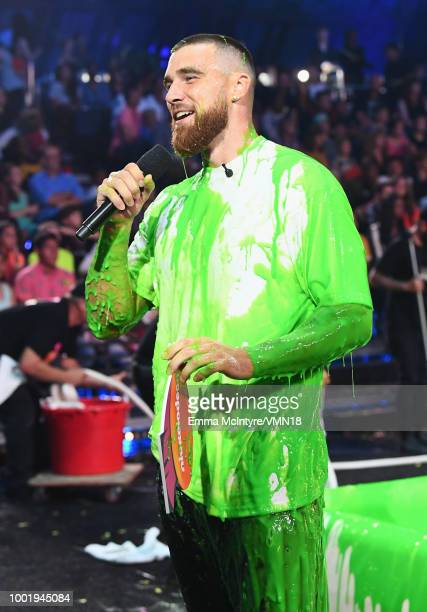 NFL player Travis Kelce speaks onstage during the Nickelodeon Kids' Choice Sports 2018 at Barker Hangar on July 19 2018 in Santa Monica California