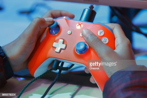 A player uses a video game controller as he plays the video game 'Super Lucky's Tale' developed by Playful Corps and published by Microsoft Studios...