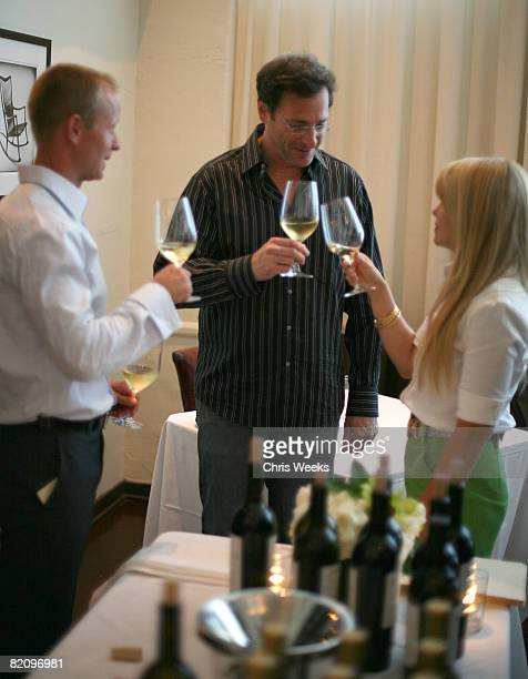 NHL player Valeri Bure actors Bob Saget and Candace Cameron Bure attend the release of Bure Family Wines at Campanile on July 28 2008 in Los Angeles...