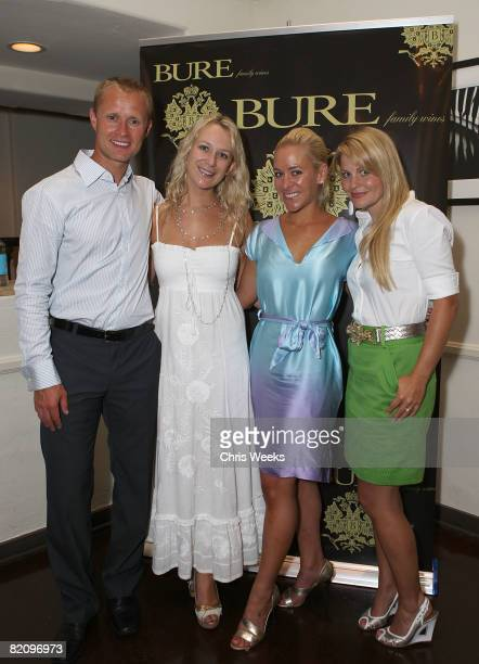NHL player Valeri Bure actress Candace Cameron and unidentified guests attend the release of Bure Family Wines at Campanile on July 28 2008 in Los...