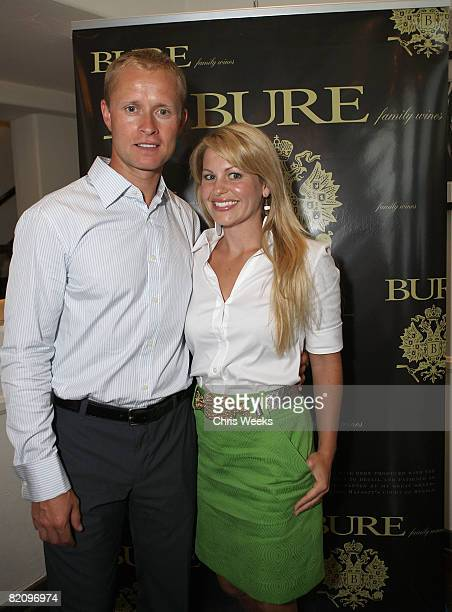 NHL player Valeri Bure and actress Candace Cameron Bure attend the release of Bure Family Wines at Campanile on July 28 2008 in Los Angeles California