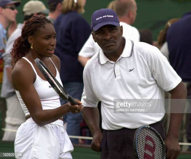US player Venus Williams and her father and coach Richard Williams discuss a point 01 July 2000 during a training session with Venus' sister Serena...