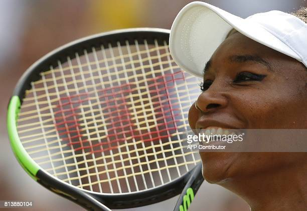 TOPSHOT US player Venus Williams celebrates beating Britain's Johanna Konta in their women's singles semifinal match on the tenth day of the 2017...