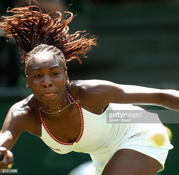 Player Venus Williams reaches out for a forehand during her first round match against Japanese Shinobu Asagoe at the All England Tennis Championships...