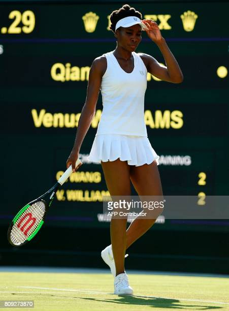 US player Venus Williams reacts after a point against China's Wang Qiang during their women's singles second round match on the third day of the 2017...