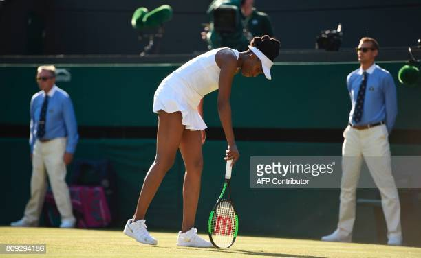 US player Venus Williams reacts after a shot against China's Wang Qiang during their women's singles second round match on the third day of the 2017...