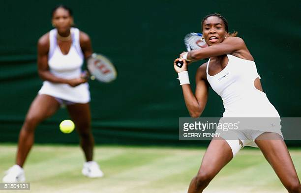 Player Venus Williams returns a ball during her Women's Doubles final match at the Wimbledon 2000 tennis tournament, which she was playing with her...