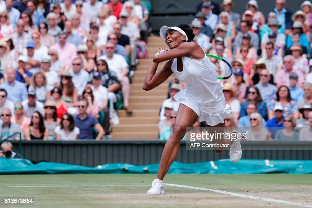 TOPSHOT US player Venus Williams returns against Britain's Johanna Konta during their women's singles semifinal match on the tenth day of the 2017...