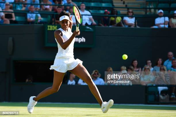 US player Venus Williams returns against China's Wang Qiang during their women's singles second round match on the third day of the 2017 Wimbledon...