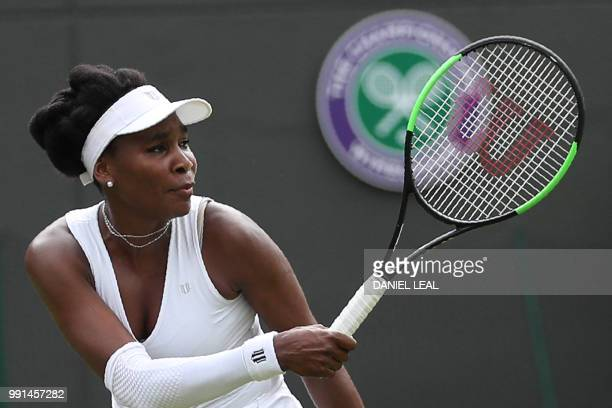 US player Venus Williams returns to Romania's Alexandra Dulgheru during their women's singles second round match on the third day of the 2018...