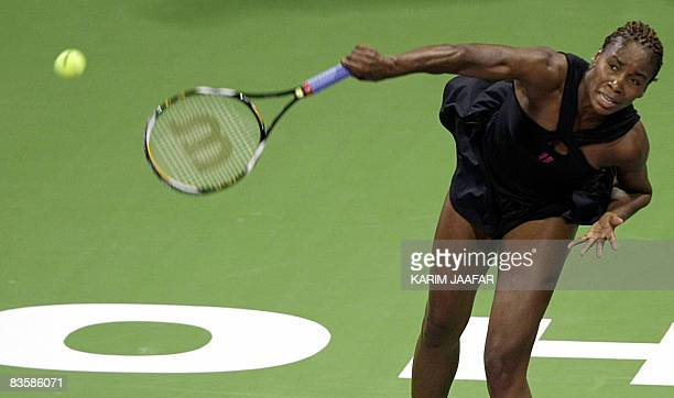 US player Venus Williams serves to her sister Serena Williams during their seasonending WTA Championships tennis match in Doha on November 6 2008...