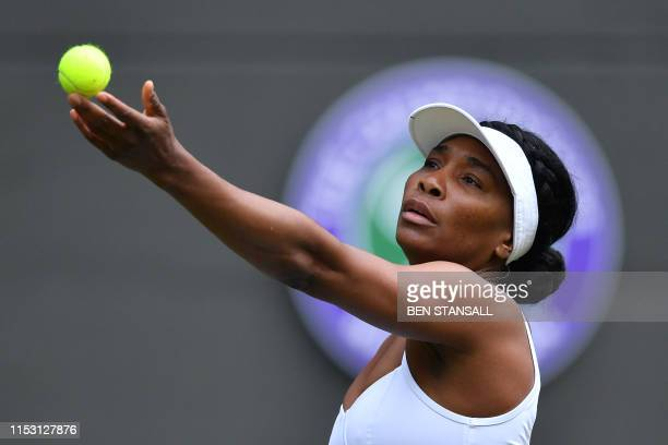 US player Venus Williams serves to US player Cori Gauff during their women's singles first round match on the first day of the 2019 Wimbledon...