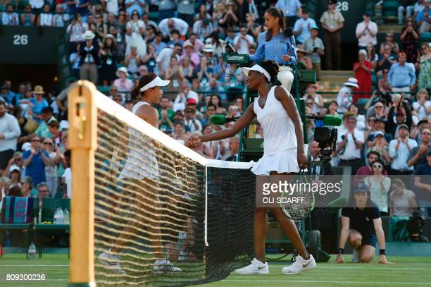 US player Venus Williams shakes hands across the net with China's Wang Qiang after Venus won their women's singles second round match on the third...