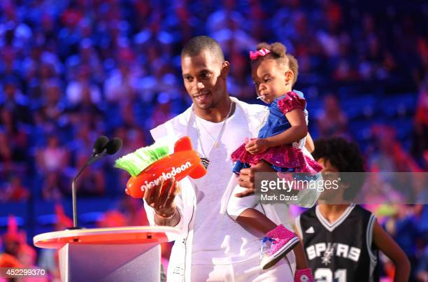 NFL player Victor Cruz and daughter Kennedy Cruz speak onstage during Nickelodeon Kids' Choice Sports Awards 2014 at UCLA's Pauley Pavilion on July...