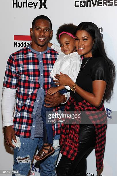 NFL player Victor Cruz wife Elaina Watley and daughter Kennedy Cruz attend the Nike/Levi's Kids Rock fashion show during Spring 2016 New York Fashion...